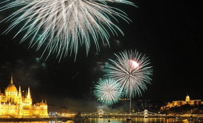 Fireworks burst over the Danube River in Budapest on August 20, 2012 during a celebration marking...