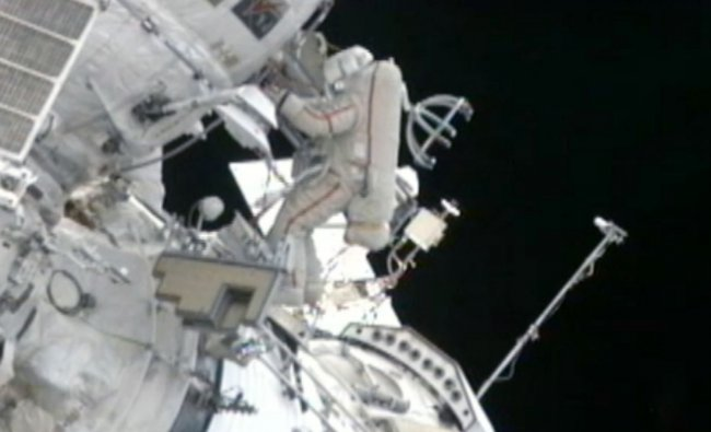 In this still image made from video provided by NASA, a Russian cosmonaut installs shields to...