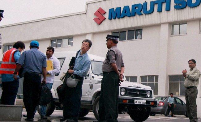 Japanese members of the management huddle at Maruti Suzuki\'s Manesar plant