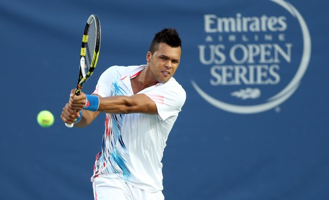 Jo-Wilfried Tsonga of France returns a shot during his match against Thomaz Bellucci of Brazil...