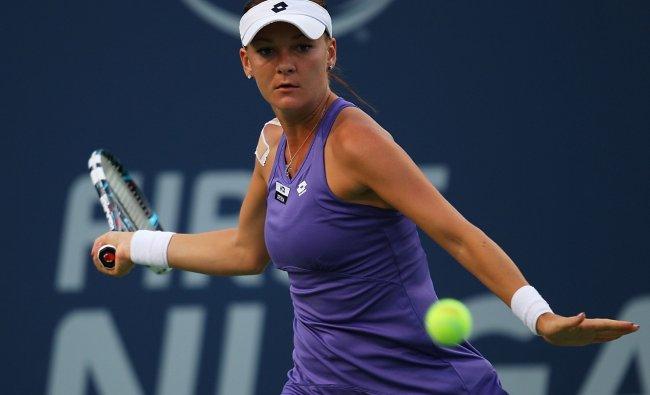 Agnieszka Radwanska of Poland returns a shot from Olga Govortsova of Belarus during the New Haven...