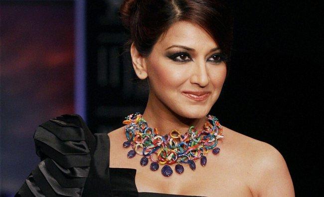 Bollywood actor Sonali Bendre walks the ramp at the India International Jewellery Week in Mumbai