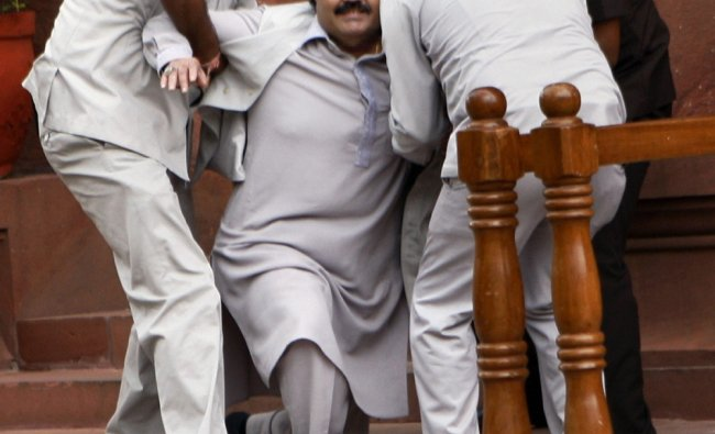 Amar Singh being helped after he slips during Parliament\'s monsoon session...