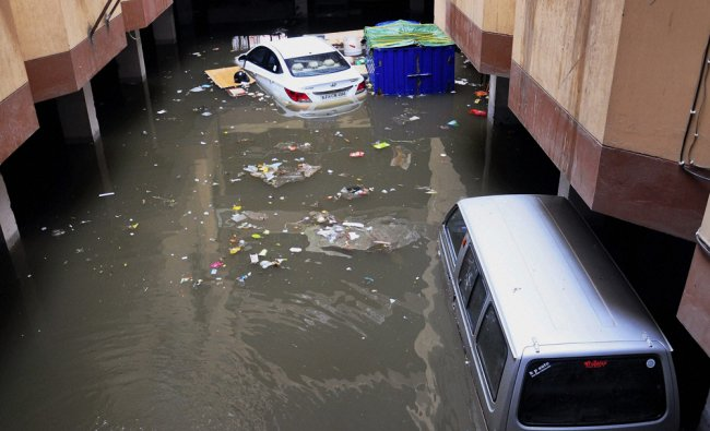 Submerged vehicles at an office following heavy rains in Jaipur