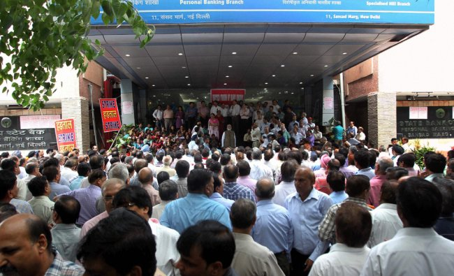 Bank employees during a protest outside the State Bank of India office in New Delhi ...
