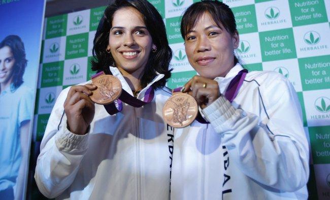 London Olympic bronze medal winners Saina Nehwal and boxer MC Mary Kom