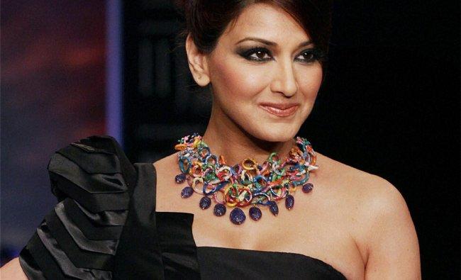 Bollywood actor Sonali Bendre walks the ramp at the India International Jewellery Week ...