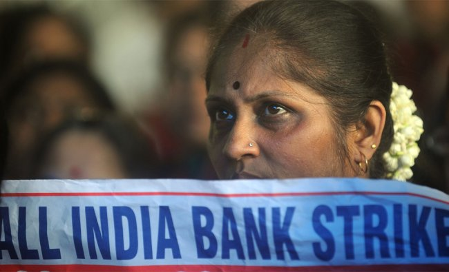 An Indian bank employee holds a placard during a protest in Mumbai on August 22, 2012. ...