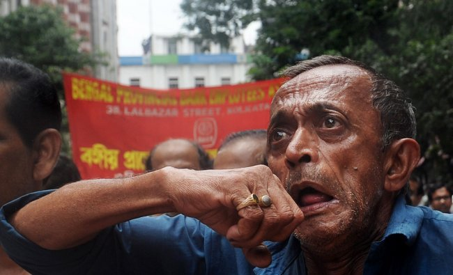 Indian employees from various nationalised and private banks shout slogans during a protest ...
