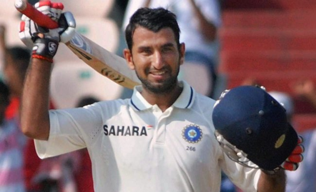 Cheteshwar Pujara celebrates his century during Day 1 of the first cricket test ...