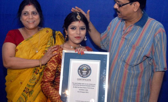 Kathak dancer Chirasree Dasgupta,22, being greeted by her parents after winning of Guinness Book ...