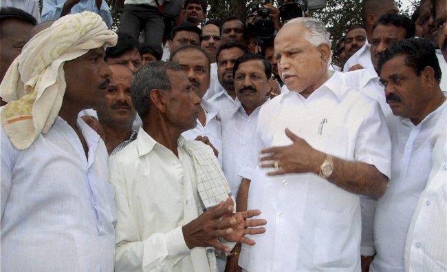 BS Yeddyurappa interacts with people during a visit to a drought-hit area...