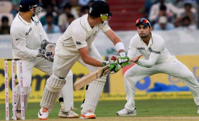 Virat Kohli takes a catch to dismiss New Zealand\'s MJ Guptill...