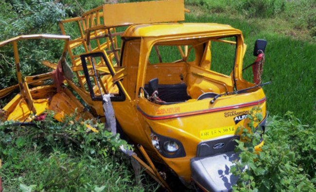 A damaged auto-rickshaw after it rammed by the Rourkela-Bhubaneswar Intercity Express at Khairapalli