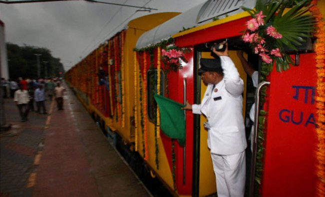A double-decker Delhi to Jaipur train leaves the station after Railway Minister Mukul Roy....