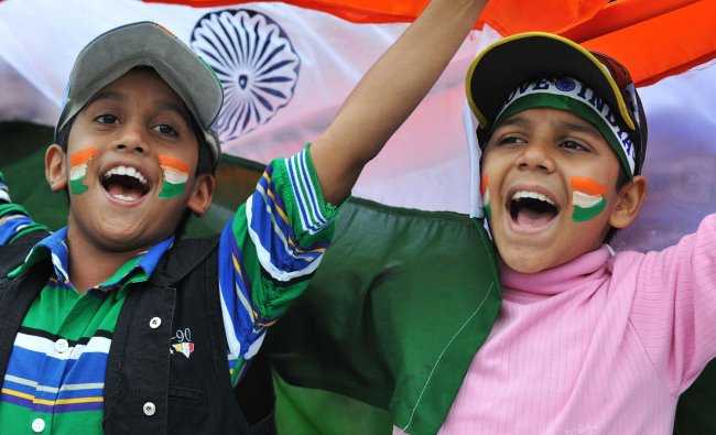 Fans cheer during the fourth day of the first Test cricket match between India and New Zealand.