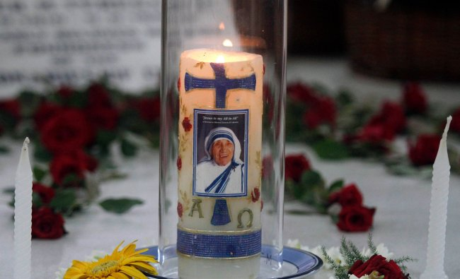 Image of Mother Teresa is seen on a candle used at a ceremony marking her 102nd birth anniversary...