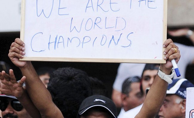 An Indian holds a sign after India defeated Australia in the 2012 ICC U19 Cricket World Cup final...