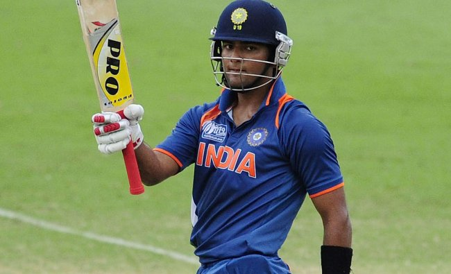 Unmukt Chand celebrates scoring a century in their victory over Australia in U-19 cricket final...