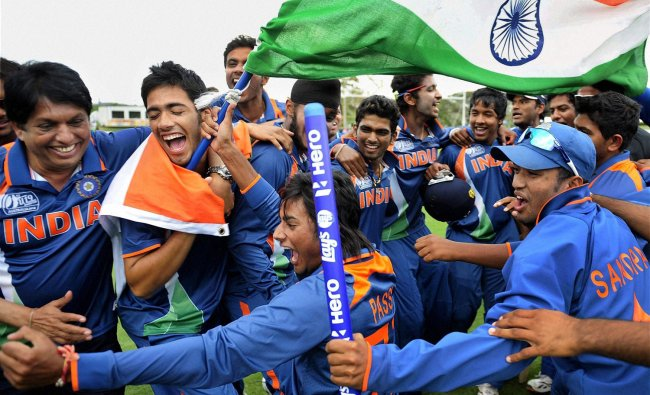 Indian players celebrate after winning the U19 Cricket World Cup at the Tony Ireland Stadium...