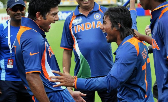 Indian skipper Unmukt Chand celebrates with teammate Kamal Passi...