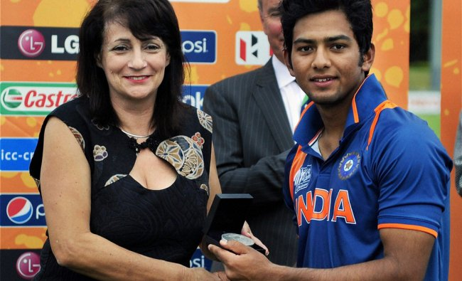 Indian skipper Unmukt Chand is presented with the player of the match award...