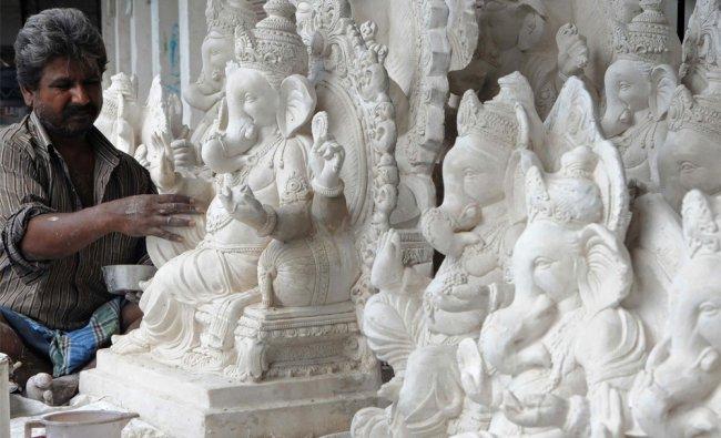Indian artist Gulab prepares idols of the Hindu God Lord Ganesha in Amritsar...