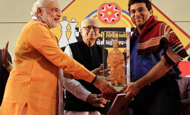 World Chess Champion Vishwanathan Anand, right, is presented with a sculpture of Swami Vivekanand...