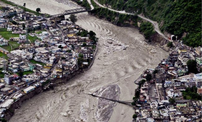 A view of a damaged bridge over the swollen Bhagirathi River in Uttarkashi district
