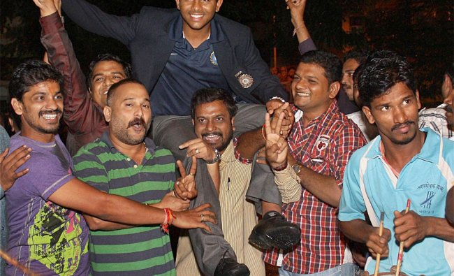 U-19 Team India player Akhilesh Herwadkar being welcomed on his arrival at his residence