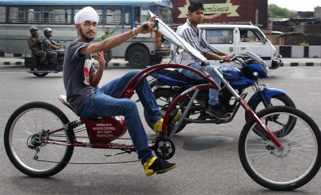 A student takes a ride in a cycle designed by himself in Jammu...