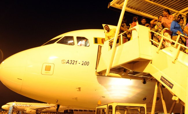 Sri Lankan pilgrims arrive at Bandaranaike International airport in Katunayaka...