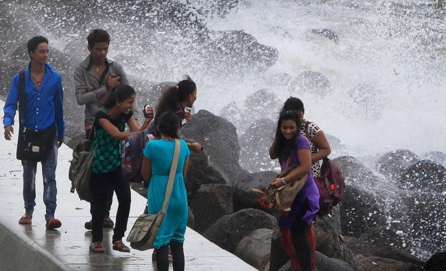 Youngsters enjoy the high tide at marine drive