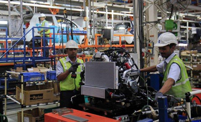 Employees work inside the General Motors plant in Talegaon