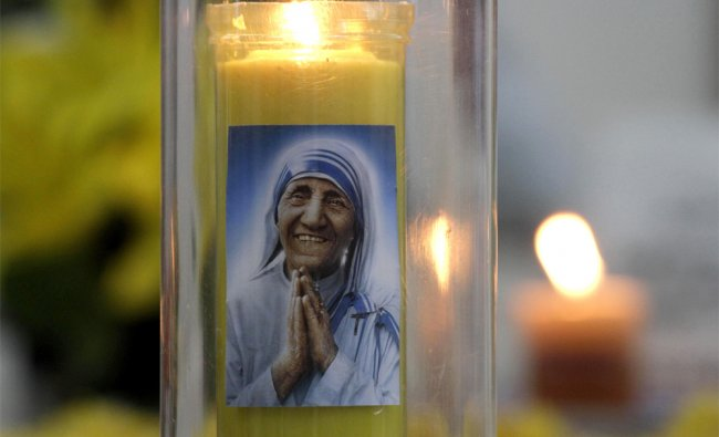 Protrait of Mother Teresa on a candle holder during a prayer on her death anniversary in Kolkata