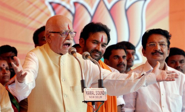 Senior BJP leader L K Advani addressing supporters at a dharna over Telangana issue...