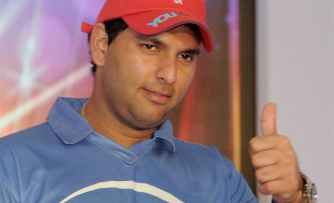 Yuvraj Singh posees for photo during a promotional event in Mumbai on Wednesday...