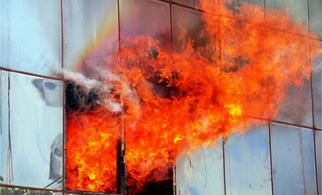 Flames come out of a building after it caught fire in Jaipur on Wednesday...