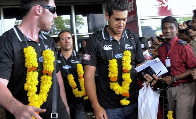 New Zealand cricket team members being greeted on their arrival at Visakhaptnam airport...