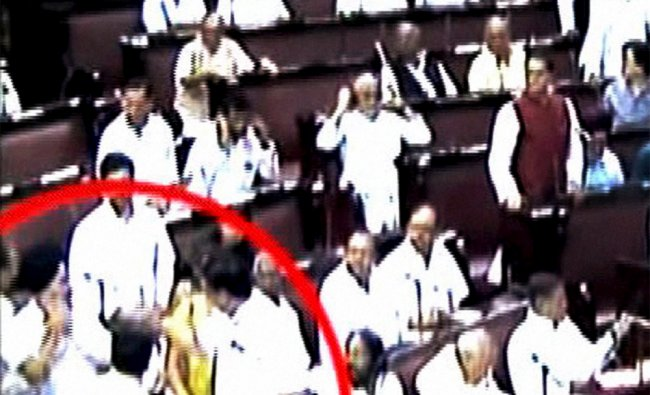 A scene of the scuffle that broke out between a SP and a BSP Members of the Parliament ...