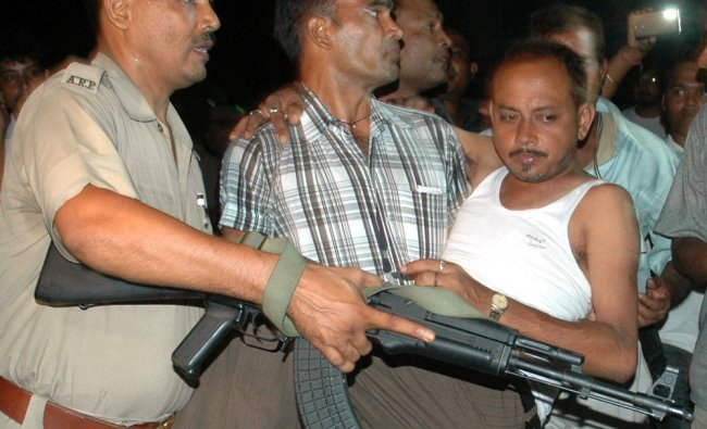 Security personnel carry an injured after a blast at Paltan Bazar area in Guwahati