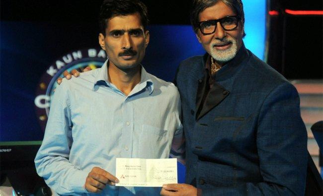 Manoj Singh Raina, with Kaun Banega Crorepati host Amitabh Bachchan after he won a crore...
