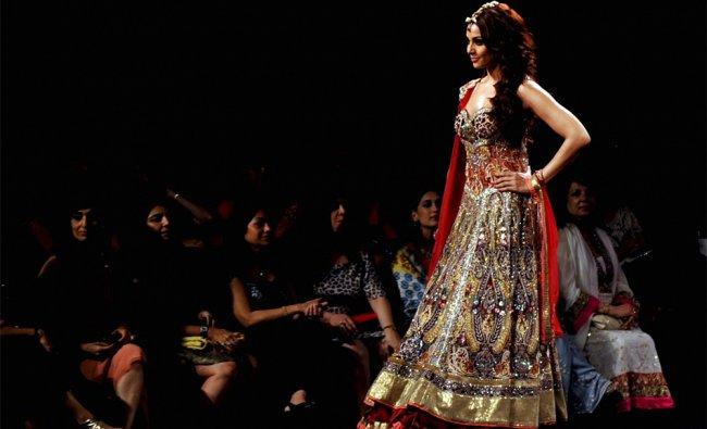 Indian Bollywood actress Bipasha Basu walks the ramp with a creation by Anjalee and Arjun Kapoor...
