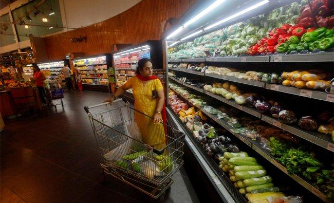 Customers shop inside a HyperCity supermarket in Mumbai...
