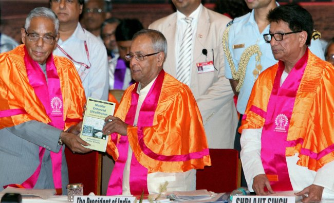 President Pranab Mukherjee and West Bengal Governor M.K. Narayanan release a research monograph...