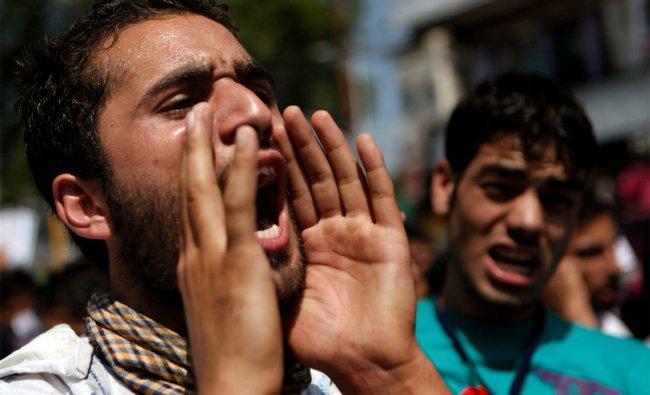 A Kashmiri Muslim student shouts slogans against the U.S., during a protest in Srinagar