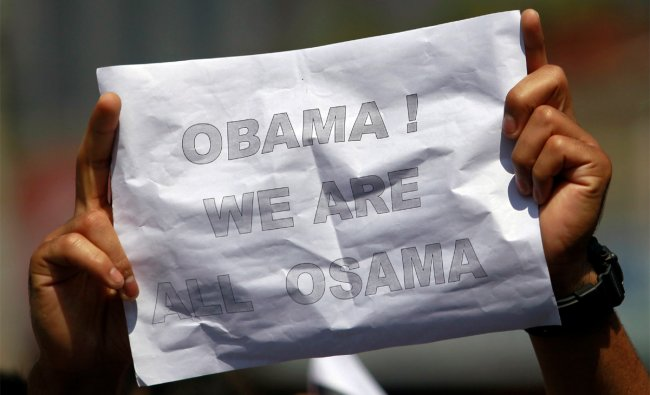 A Kashmiri student holds up a sign during an anti-U.S. protest against a film