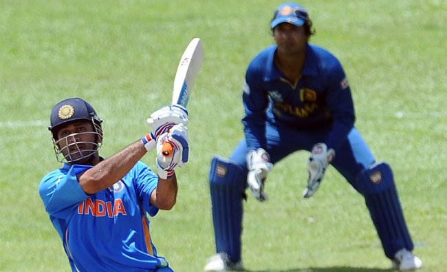 M.S Dhoni plays a shot against Sri Lanka during the ICC Twenty20 Cricket World Cup warm-up match