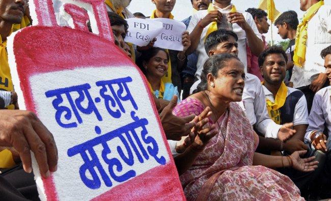 Gujarat Parivartan Party workers shout slogans during a protest