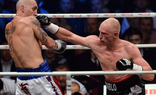 Krzysztof Wlodarczyk punches Francisco Palacios during their WBC cruiserweight title bout